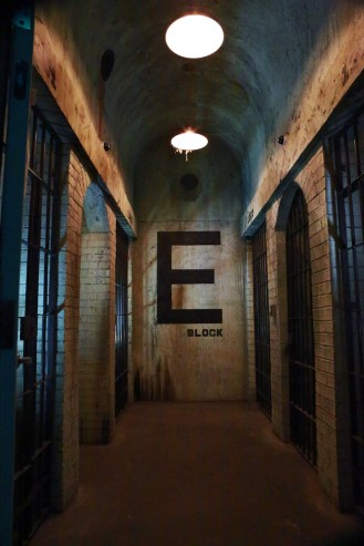 In-game: An incredibly realistic of an old, rundown prison cellblock hallway.
