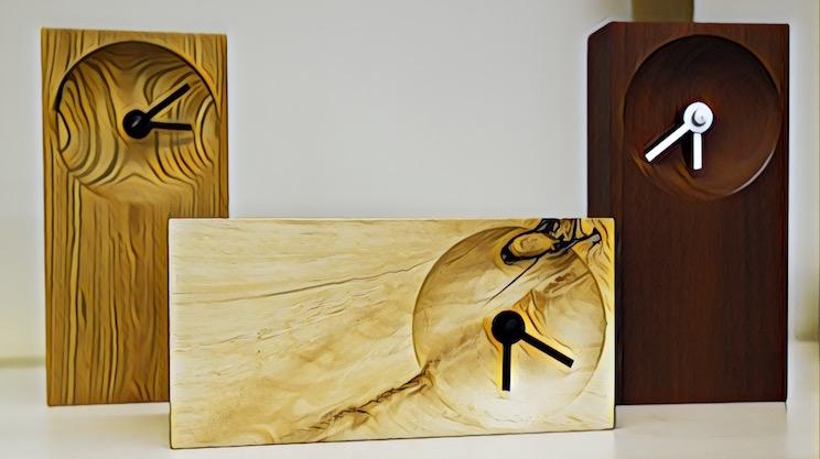 Stylized image of three beautifully handcrafted, minimalistic wood clocks.