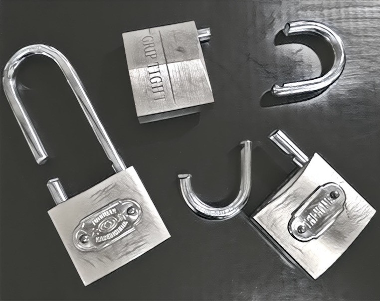 Black & white image of three padlocks that have been cut and destroyed with bolt cutters.