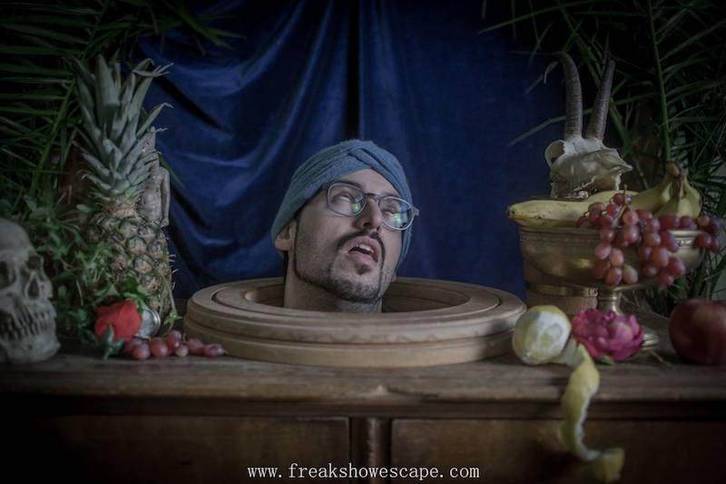 David's head on a platter surrouned by fruit. He looks dead.