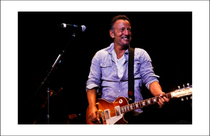 Image of Bruce Springsteen on stage with a Gibson Les Paul