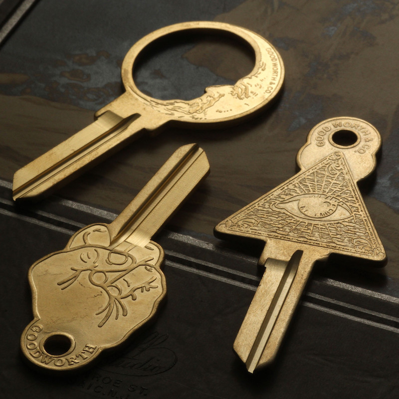 Three gold keys, one that looks like a middle finger, an all seeing eye, and a crescent moon.