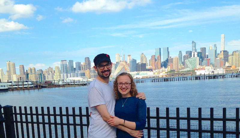 Lisa and David along the Hudson River, New York City in the background.