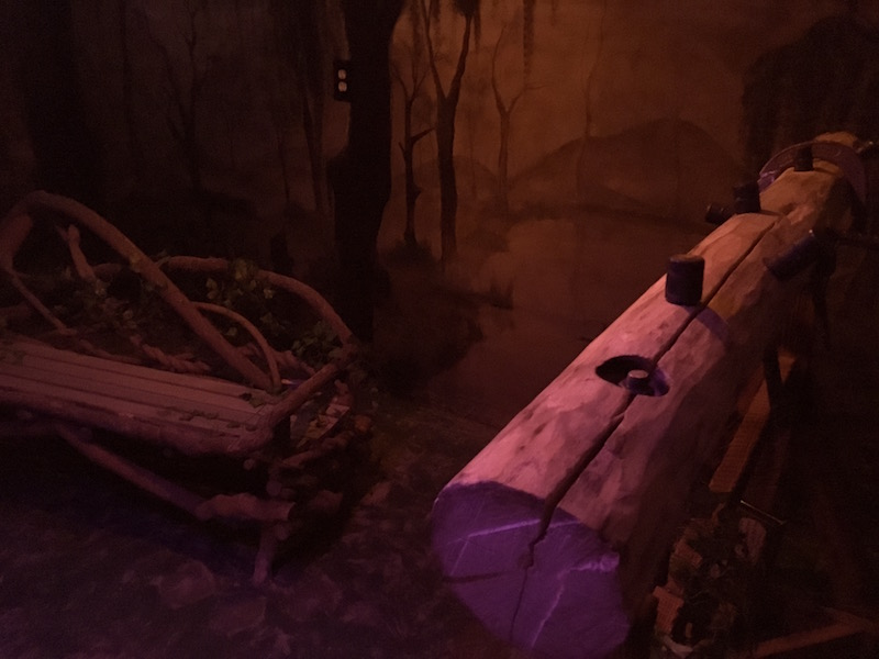 In game - A strange wooden contraption beside a bench made of vines.