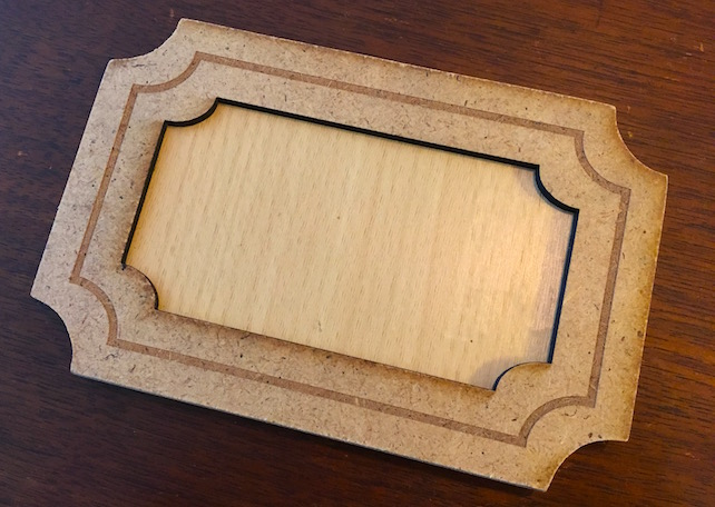 The illuminating wood puzzle. It looks like a wooden frame around another piece of wood.