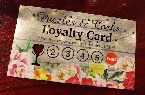 A Puzzles & Corks loyalty card. The 6th game is free.