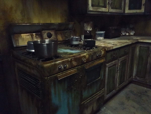 In-game: An old 1960s kitchen with a disgusting blue cooking range.