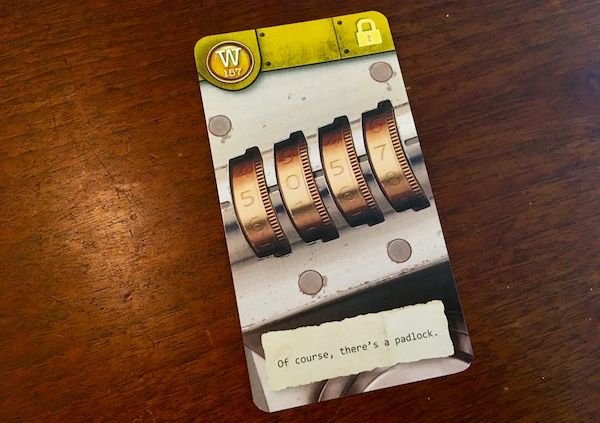 "Yellow card depicting a combination padlock. The flavor text of the cards reads, ""Of course, there's a padlock."""