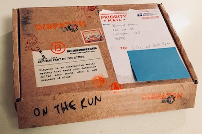Dispatch, On The Run box. A cardboard shipping box made to look like it was covered in stamps.