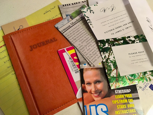 An assortment of papers from Dispatch, On The Run. Newspaper clippings, a journal, wedding invitation, a wedding toast, the cover of a tabloid magazine.