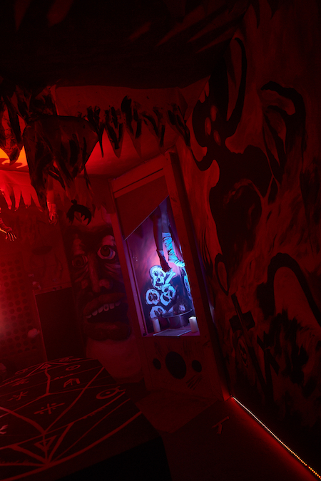 In-game: A red and black room filled with ghosts and skeletons.