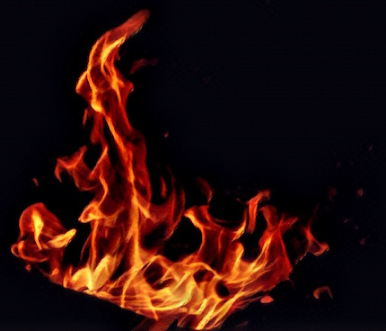 Image of a fire glowing against a black background.