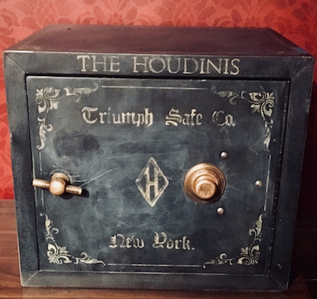 "A large old safe that reads, ""The Houdinis. Triumph Safe Co. New York."""
