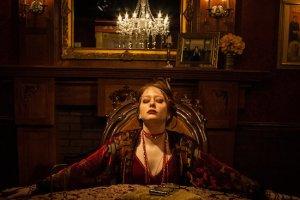 Madame Daphne holding a seance.