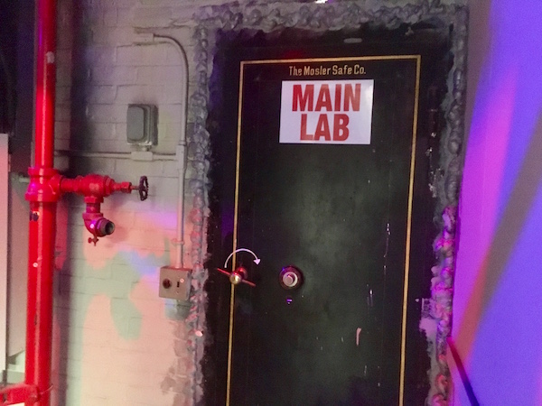 "In-game: A large safe door labeled, ""MAIN LAB."""