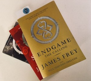 The three installments of the End Game series. The gold covered first volume is on top of the pile.