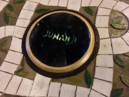"""In-game: A close up of the message window on a Jumanji board. It reads, """"Jumanji."""""""