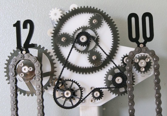 A strange clock made of many gears and bicycle chains.