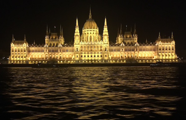 The palace in Budapest lit at night.