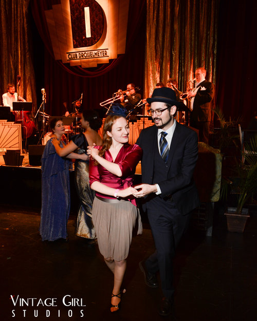 Lisa and David dressed up and swing dancing on the Club Drosselmeyer floor.