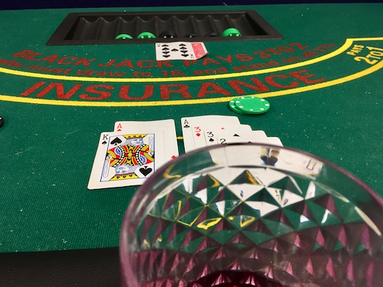 In-game: A card table with blackjack in progress.