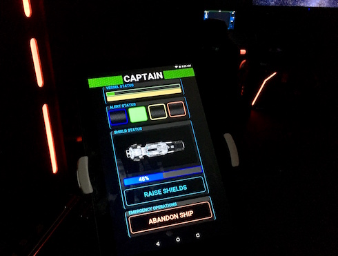 In-game: A captain's Android tablet with controls for the shields and emergency operations.