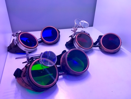 In-game: Three steampunk goggles with different colored lenses.