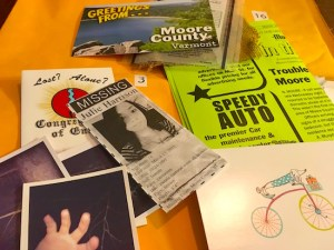In-game: An assortment of newspaper clippings, cards, pamphlets, and photos from the game.