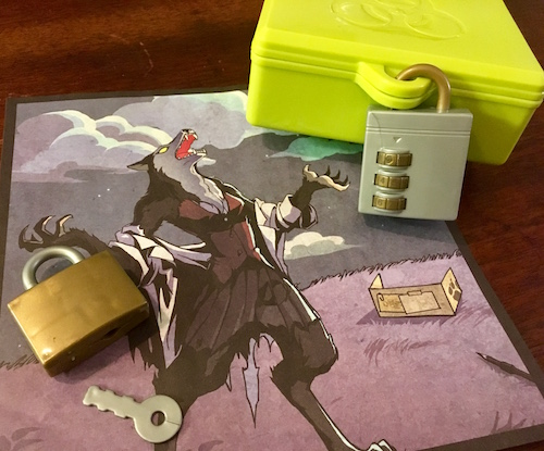 In-game: a green biohazard box locked with a plastic 3 digit lock, a gold plastic warded lock, and art depicting a female werewolf.