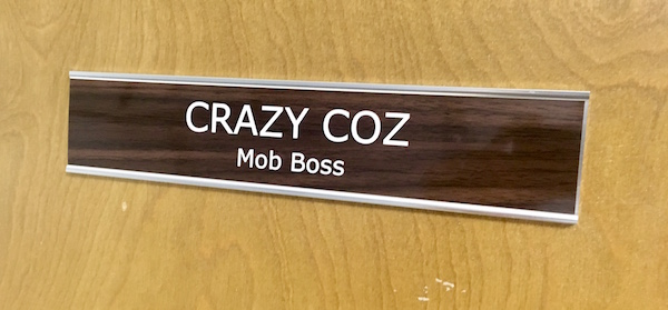 "Game Door: Door placard that reads ""Crazy Coz Mob Boss"""