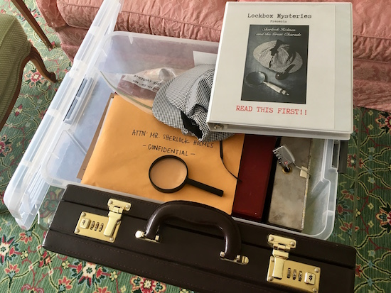 "The plastic crate open revealing an assortment of lock boxes, an envelope labeled ""confidential"" and a binder that says, ""Read First."""