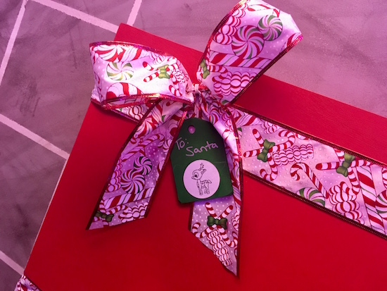 """In-game: a wrapped christmas present labeled """"To Santa"""""""
