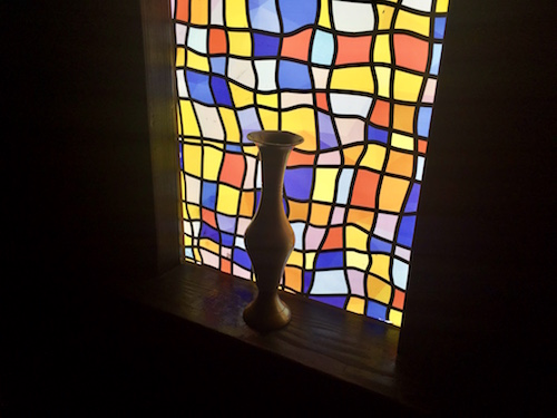 In-game: A vase sitting in a glowing stained glass window.