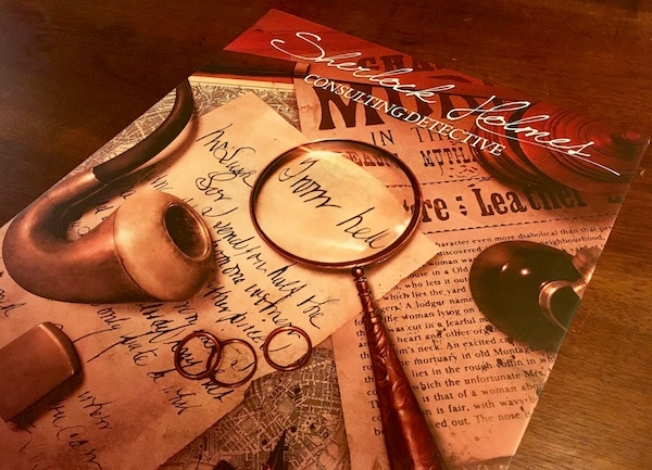 "Beautiful Sherlock Holmes Consulting Detective box art featuring a pipe, and a magnifying glass over a letter that reads, ""From Hell."""