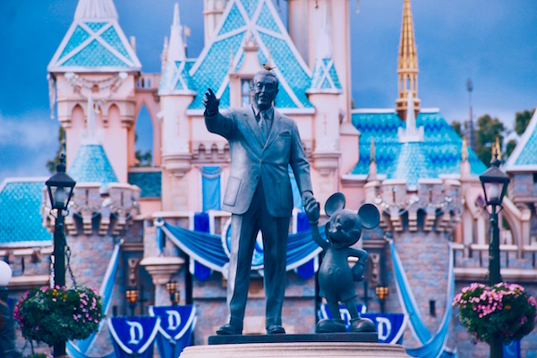 Image from Disneyland in Anaheim. Statue of Walt Disney holding Mickey Mouse's hand in front of Cinderella's Castle.