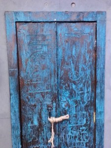 The blue and brown doorway to enter the game with Egyptian hieroglyphs carved into it.