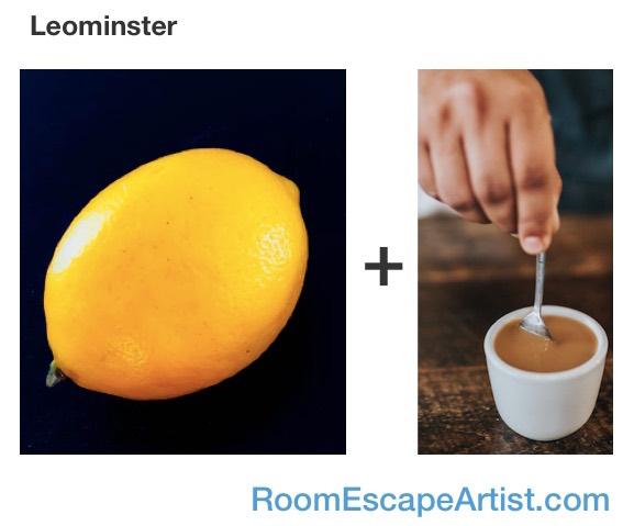 Leominster rebus - a lemon plus a hand stirring coffee.