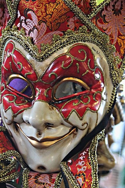 A red and gold Mardi Gras mask.