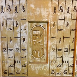 In-game: A wall of hieroglyphs and a cartouche.