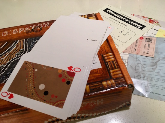 Dispatch by Breakout – On the Run, Box 4 with a strange deck of cards and assorted papers from the box.