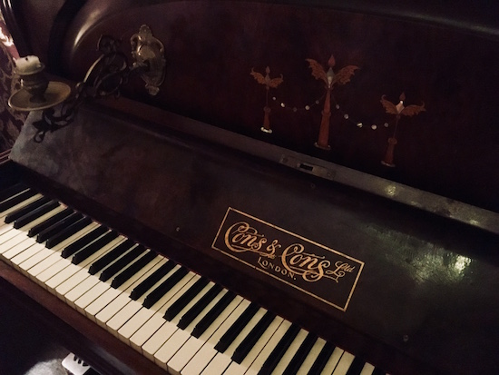 In-game: A closeup of an old wooden piano.