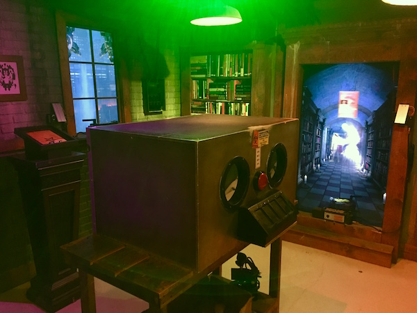 In-game: The main set of the Ghostbusters firehouse. There is a large box in the middle of the room for manipulating hazardous objects.