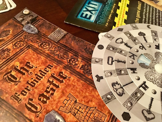 Exit The Game: The Forbidden Castle's booklet and decoder wheel.