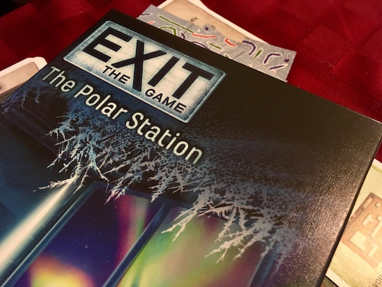 Exit The Game: The Polar Station box held over assorted game components.