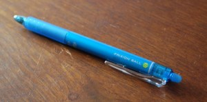 A blue FriXion Ball pen
