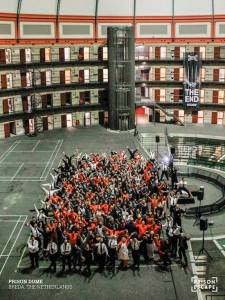 The entire cast and all of the players of Prison Escape on the floor of the Prison Dome.