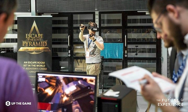 Someone playing the Ubisoft VR Escape The Lost Pyramid escape room set in the wold of Assassin's Creed Origins.