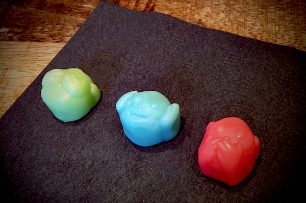 "Close up of the ""see no evil hear no evil speak no evil monkeys"" gummi monkeys."