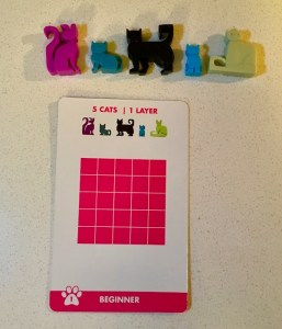 The first puzzle layout for Cat Stax and the corresponding cat pieces.