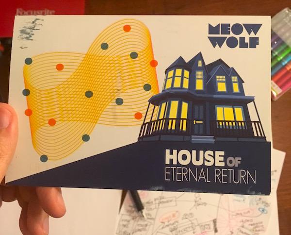 A Meow Wolf House of Eternal Return postcard.